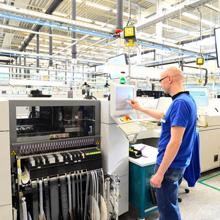 man reading data at a factory