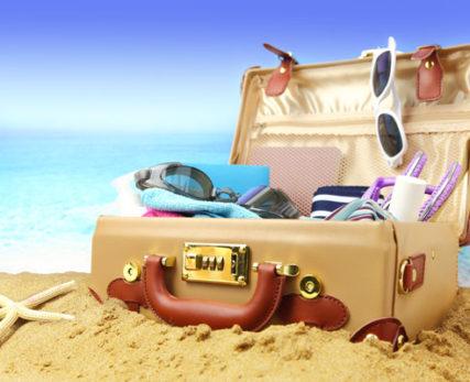 luggage sitting open on a beach
