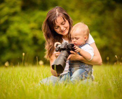 woman with a baby and camera