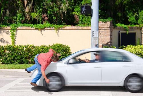 Pedestrian being struck by a vehicle