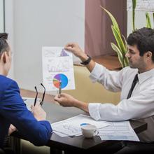 man presenting graph